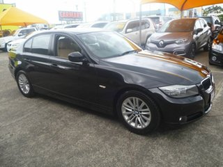 2009 BMW 320i E90 MY10 Executive Steptronic Black 6 Speed Sports Automatic Sedan.