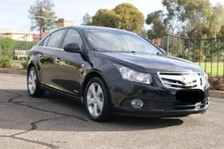 2010 Holden Cruze JG CDX Black 6 Speed Automatic Sedan.
