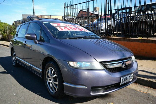 Used Honda Odyssey 20 MY06 Upgrade Luxury, 2006 Honda Odyssey 20 MY06 Upgrade Luxury Purple 5 Speed Sequential Auto Wagon