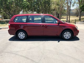 2013 Kia Grand Carnival VQ MY14 S Red 6 Speed Automatic Wagon.