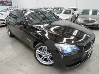 2011 BMW 7 Series F01 MY1110 730d Steptronic Black 6 Speed Sports Automatic Sedan.