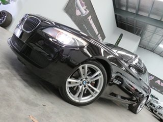 2011 BMW 7 Series F01 MY1110 730d Steptronic Black 6 Speed Sports Automatic Sedan