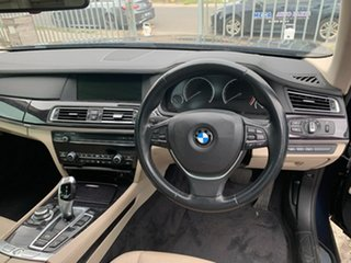 2011 BMW 7 Series F01 MY1110 730d Steptronic Blue & Black 6 Speed Sports Automatic Sedan