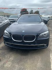 2011 BMW 7 Series F01 MY1110 730d Steptronic Blue & Black 6 Speed Sports Automatic Sedan.
