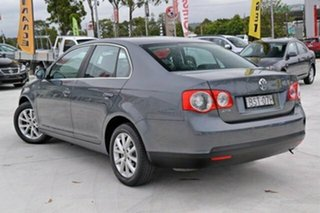2010 Volkswagen Jetta 1KM MY10 118TSI DSG Grey 7 Speed Sports Automatic Dual Clutch Sedan.