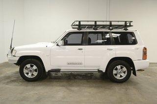 2010 Nissan Patrol GU 7 MY10 ST White 4 Speed Automatic Wagon.