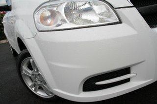 2011 Holden Barina TK MY11 Arctic White 4 Speed Automatic Sedan.