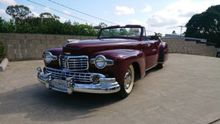 1948 Lincoln Continental Cabriolet Maroon 3 Speed Manual Cabriolet.