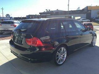 2012 BMW 320d E91 MY11 Lifestyle Touring Steptronic Black 6 Speed Sports Automatic Wagon.