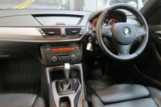 2012 BMW X1 E84 MY0312 sDrive20d Steptronic White 6 Speed Sports Automatic Wagon.