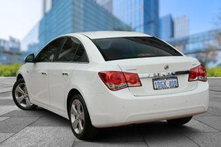 2010 Holden Cruze JG CDX White 6 Speed Sports Automatic Sedan.