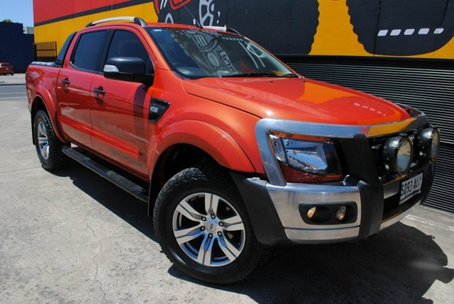 Used Ford Ranger PX Wildtrak Double Cab, 2012 Ford Ranger PX Wildtrak Double Cab Chilli Orange 6 Speed Manual Utility