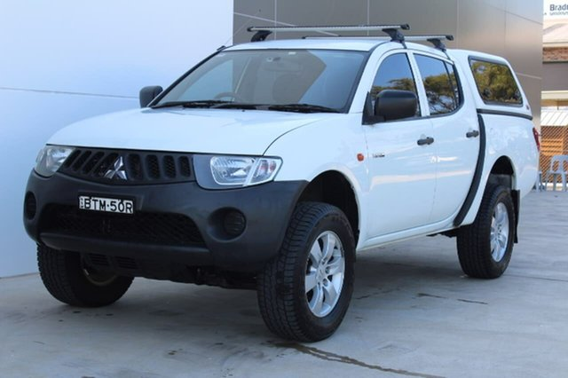 Used Mitsubishi Triton ML MY09 GLX Double Cab 4x2, 2009 Mitsubishi Triton ML MY09 GLX Double Cab 4x2 White 5 Speed Manual Utility