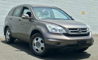 2009 Honda CR-V RE MY2007 4WD Deep Metallic Bronze 6 Speed Manual Wagon.