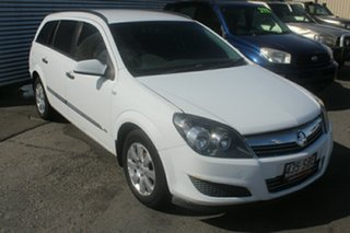 2008 Holden Astra AH MY08.5 60th Anniversary White 4 Speed Automatic Wagon.