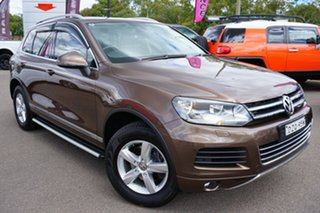 2011 Volkswagen Touareg 7P MY11 150TDI Tiptronic 4MOTION Brown 8 Speed Sports Automatic Wagon.