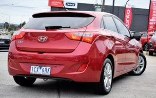 2014 Hyundai i30 GD MY14 Elite Red/Black 6 Speed Sports Automatic Hatchback.