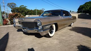 1965 Cadillac De Ville Gold 3 Speed Automatic Coupe.