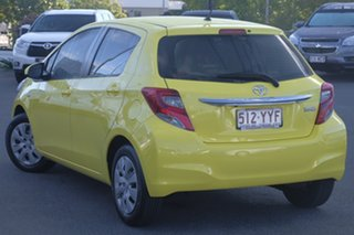 2015 Toyota Yaris NCP130R Ascent Luminous Yellow/grey 4 Speed Automatic Hatchback.