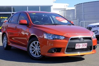 2012 Mitsubishi Lancer CJ MY13 LX Orange 5 Speed Manual Sedan.