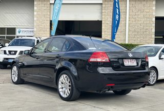 2010 Holden Commodore VE MY10 International Black 6 Speed Sports Automatic Sedan.