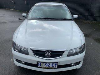 2003 Holden Calais VY White 4 Speed Automatic Sedan.