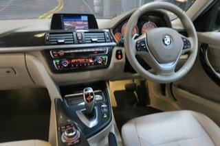 2012 BMW 3 Series F30 MY0812 328i Bronze 8 Speed Sports Automatic Sedan.
