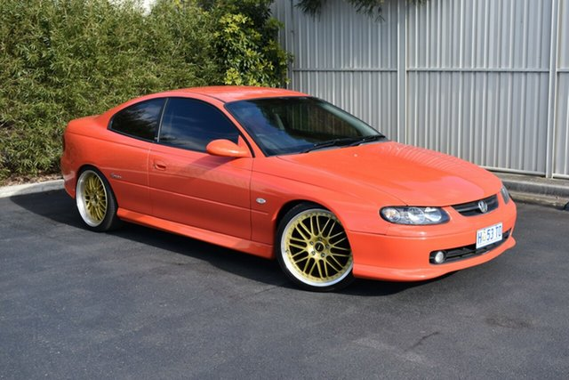 Used Holden Monaro V2 CV8, 2002 Holden Monaro V2 CV8 Orange 6 Speed Manual Coupe