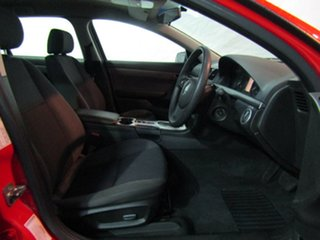 2009 Holden Commodore VE MY10 Omega Sportwagon Red Hot/onyx Trim 6 Speed Sports Automatic Wagon