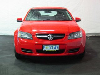 2009 Holden Commodore VE MY10 Omega Sportwagon Red Hot/onyx Trim 6 Speed Sports Automatic Wagon.
