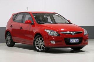 2012 Hyundai i30 FD MY12 Trophy Red 4 Speed Automatic Hatchback.