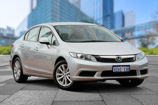 2013 Honda Civic 9th Gen Ser II MY13 VTi-L Silver 5 Speed Sports Automatic Sedan.