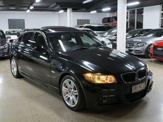 2009 BMW 3 Series E90 MY10 320i Steptronic Executive Black Sapphire 6 Speed Sports Automatic Sedan.