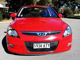2012 Hyundai i30 FD MY11 Trophy Red/Black 4 Speed Automatic Hatchback.