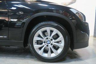 2011 BMW X1 E84 MY0911 sDrive18i Steptronic Black 6 Speed Sports Automatic Wagon.