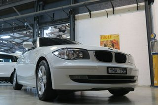2011 BMW 118i E87 MY11 118i White 6 Speed Automatic Hatchback.