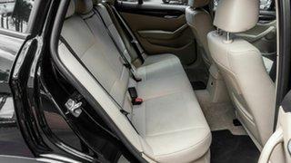 2011 BMW X1 E84 MY11 sDrive18i Steptronic Black 6 Speed Sports Automatic Wagon