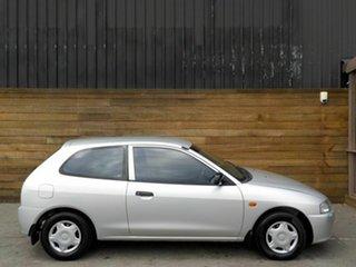 2000 Mitsubishi Mirage CE Silver 5 Speed Manual Hatchback.