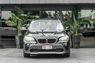 2011 BMW X1 E84 MY11 sDrive18i Steptronic Black 6 Speed Sports Automatic Wagon.