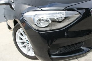 2014 BMW 1 Series F20 MY0713 116i Steptronic Black 8 Speed Sports Automatic Hatchback.