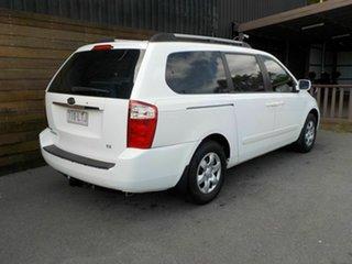 2009 Kia Grand Carnival VQ EX White 5 Speed Automatic Wagon.