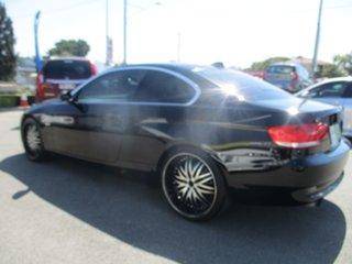 2009 BMW 3 Series E92 MY09 323i Steptronic Black 6 Speed Sports Automatic Coupe.