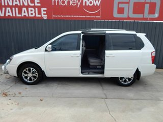 2014 Kia Grand Carnival VQ MY14 SLi White 6 Speed Sports Automatic Wagon.
