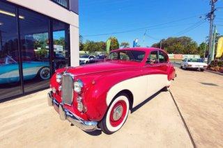 1959 Jaguar Mark IX Red & White Automatic Sedan.