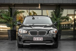 2010 BMW X1 E84 MY11 xDrive25i Steptronic Black 6 Speed Sports Automatic Wagon.