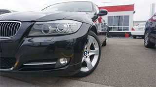 2011 BMW 320i 3 Black 6 Speed Automatic Sedan.