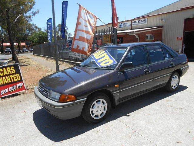 Used Ford Laser KF GL, 1990 Ford Laser KF GL Burgundy 3 Speed Automatic Sedan