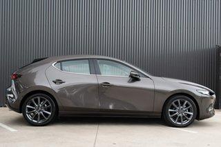 2019 Mazda 3 BP2H7A G20 SKYACTIV-Drive Evolve Titanium Flash 6 Speed Sports Automatic Hatchback.