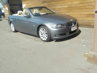 2009 BMW 3 Series E93 MY10 320d Steptronic Grey 6 Speed Sports Automatic Convertible.