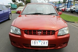 2000 Hyundai Accent LC GLS Red 4 Speed Automatic Hatchback.